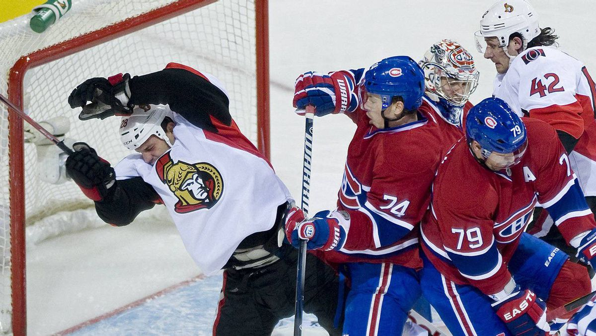 Ottawa Senators' Zenon Konopka, left, collides with Montreal Canadiens' Alexei Emelin (74) as Canadiens' goaltender Carey Price, centre, Andrei Markov (79) and Senators' Jim O'Brien look for the puck during second period NHL hockey action in Montreal, Friday, March 23, 2012. THE CANADIAN PRESS/Graham Hughes