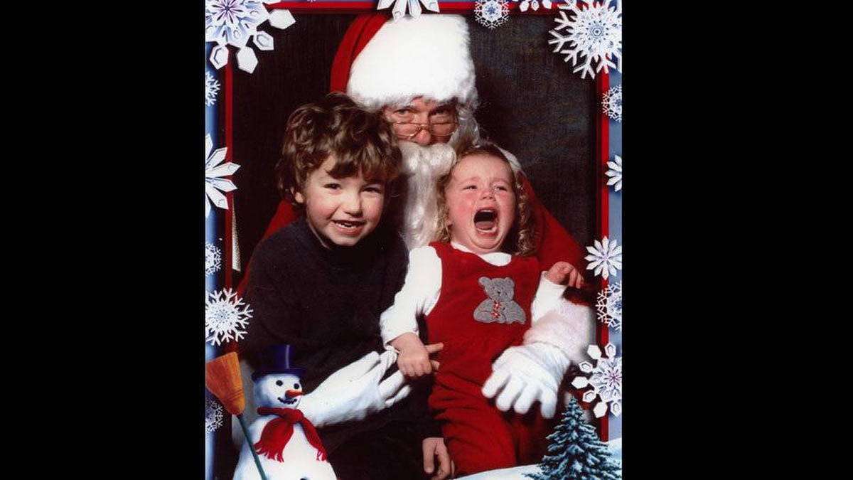 Tricia Redmond writes: My daughter, Paige (1 year) was terrified of Santa. My son, Conor (4 years) could not care less that his sister was losing her mind, he was just so happy to see Santa. Santa was not impressed - Paige had a very ear-piercingly loud scream!!!