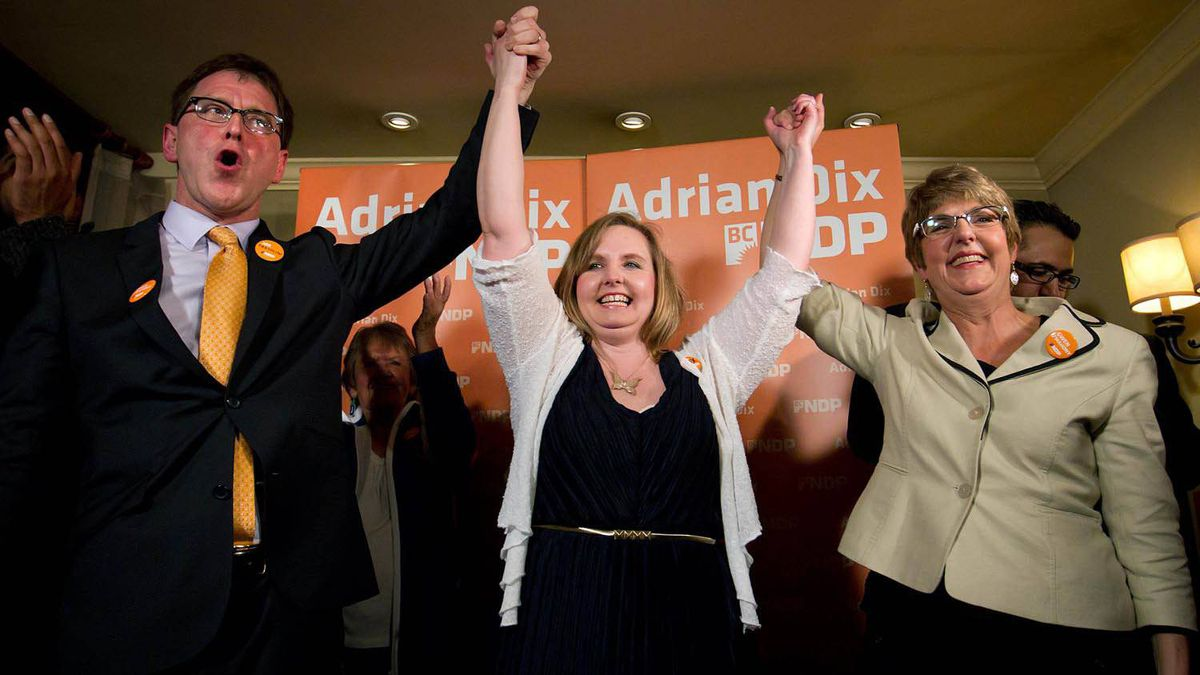 NDP MLA-elect Gwen O'Mahony, centre, celebrates her by-election win in the riding of Chilliwack-Hope with B.C. NDP Leader Adrian Dix, left, and former leader and current MLA Carole James, right, in Chilliwack, B.C., on April 19, 2012.