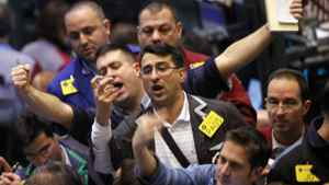 Traders work the crude oil options pit at the New York Mercantile Exchange.