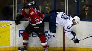 Abbotsford Heat's J.P. Testwuide upends the Toronto Marlies' Nazem Kadri during American Hockey League playoff action at Ricoh Coliseum in Toronto on May 3/2012.
