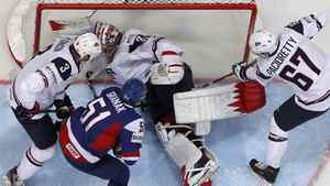 Jack Johnson (L), goalkeeper Jimmy Howard and Max Pacioretty of the U.S. try to save their their net as Slovakia's Dominik Granak (2nd L) scores during their 2012 IIHF men's ice hockey World Championship game in Helsinki May 7, 2012. Slovakia won 4-2. REUTERS/Grigory Dukor