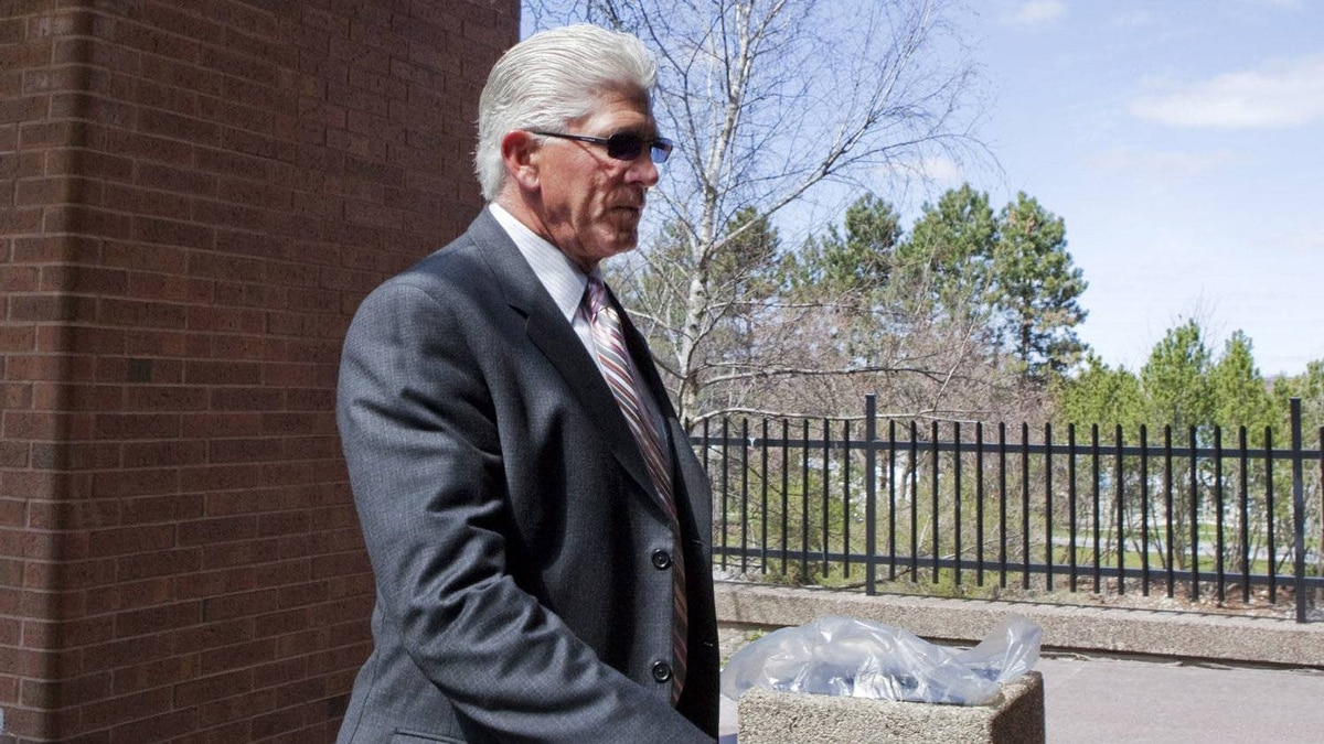Former Toronto Maple Leafs captain Rick Vaive enters a courthouse where he is expected to receive his sentence on impaired driving charges in Newmarket, Ont., on Thursday, April 12, 2012.