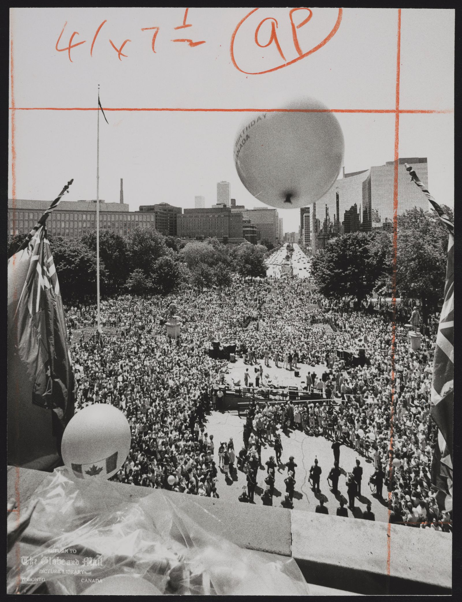DOMINION DAY Balloons are released from the Ontario Legislature balcony as thousands of people arrive to join the Dominion Day celebrations for Canada's 115th birthday yesterday, [July 1, 1982].