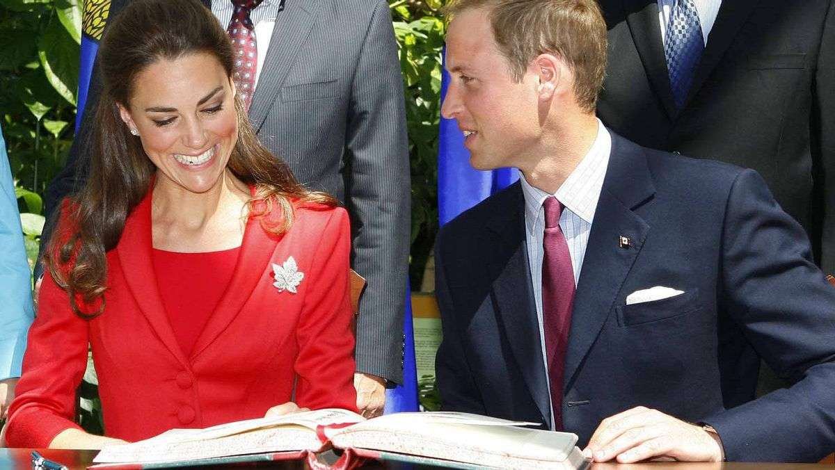 The Duke and Duchess of Cambridge sign a guest book at the ENMAX Conservatory at the Calgary Zoo in Calgary, Friday July 8, 2011.