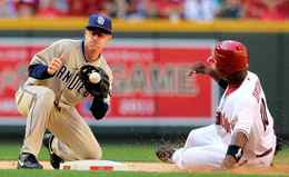 Infielder David Eckstein of the San Diego Padres catches the ball as Justin Upton of the Arizona Diamondbacks safely steals second base during the seventh inning at Chase Field in Phoenix, Arizona.