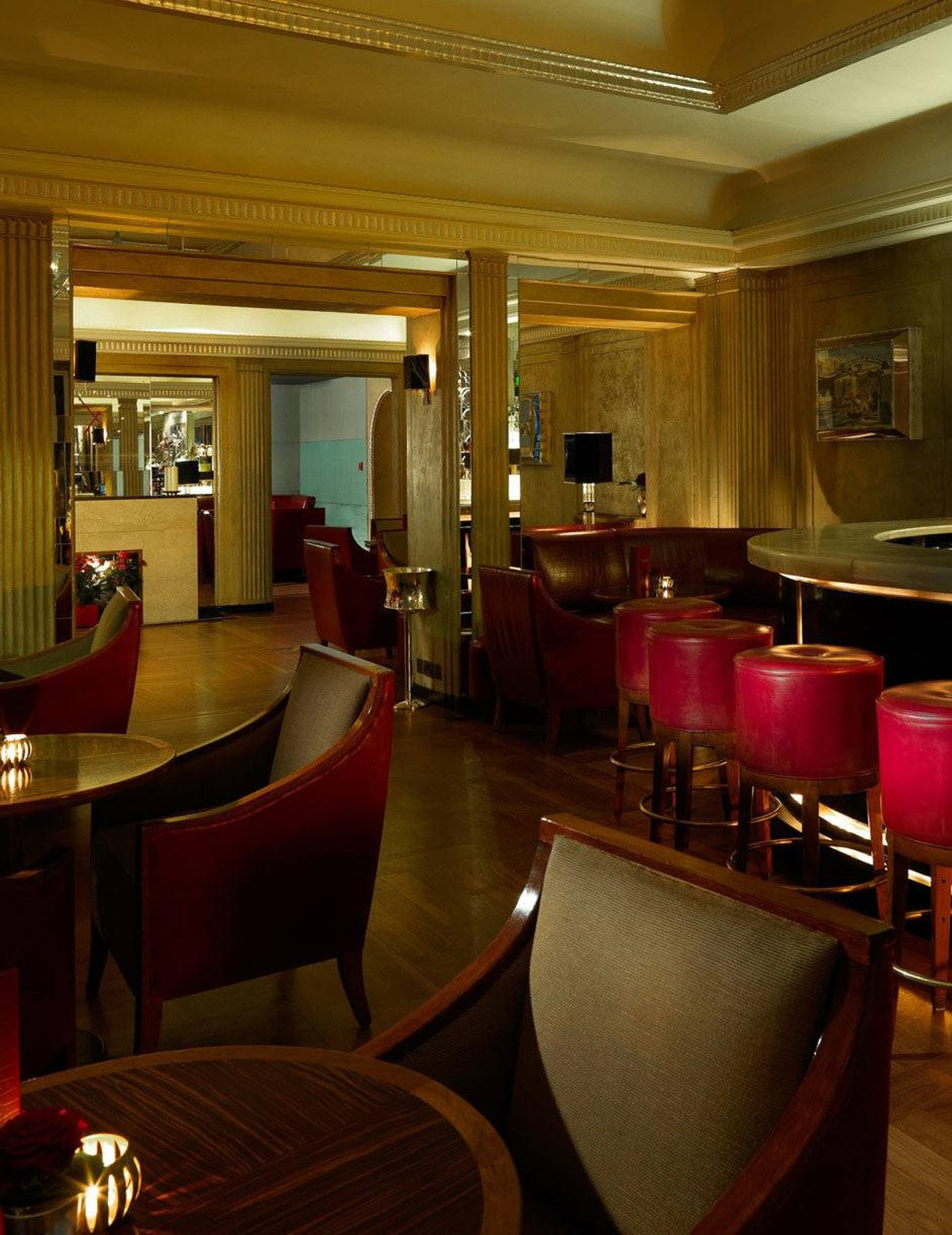 Claridge's Bar at Claridge's: This Mayfair hotel bar is worth a stop, if only to see how the Other Half lives while on holiday - the Other Half being those of aristocratic stock. With its origins dating to 1812, the hotel has long been referred to as an extension of Buck House (Buckingham Palace). And it has a hushed, I-feel-like-I'm-in-a-palace atmosphere. Wear your best shoes. Coif your hair. Polish up your manners. This is not a place for a boisterous gathering. Once, long ago, I stayed here. The staff packed up our suitcases to move us to another room. The King and Queen of Spain were visiting, and they needed a whole floor for their entourage. Oh, pardon me.