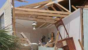 A Florida home is damaged in 2005 after it was struck by Hurricane Dennis. This type of occurance demonstrates the need for proper insurance.