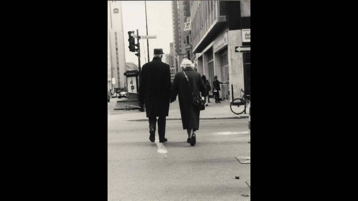 Charlie Gregory aka selrahcyrogerg on Flickr photo: Lovers Montreal - two lovers share a moment as they pass along a busy Rue in downtown Montreal, circa 1997 or so.