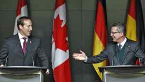 Defence Minister Peter MacKay and his German counterpart, Thomas de Maiziere, hold a news conference at National Defence headquarters in Ottawa on Feb. 14, 2012.