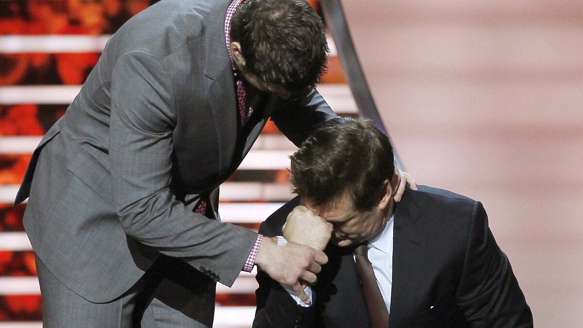 Denver Broncos quarterback Tim Tebow (L) helps host Alec Baldwin with his trademark pre-game pose during the inaugural National Football League Honours at the Super Bowl XLVI in Indianapolis, Indiana February 4, 2012. REUTERS/Lucy Nicholson