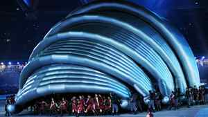Scottish performers assemble a replica of Glasgow's Clyde Auditorium, familiarly known as 'The Armadillo', at the XIX Commonwealth Games closing ceremony at Jawarharlal Nehru Stadium in New Delhi on Thursday. Glasgow, Scotland's biggest city, will host the 2014 event.
