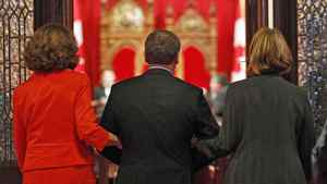 Re-appointed Conservative senator Fabian Manning is escorted into the Red Chamber during a Parliament Hill swearing-in ceremony on June 7, 2011.