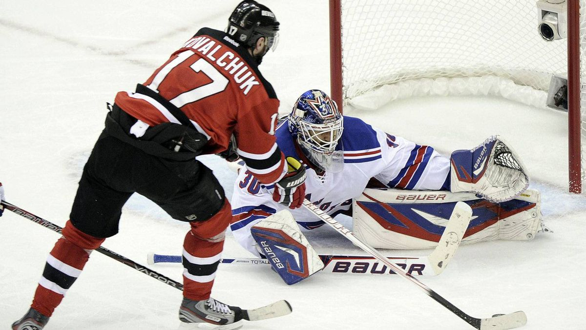 New York Rangers goalie Henrik Lundqvist (R) makes a save on New Jersey Devils' Ilya Kovalchuk during the second period in Game 3 of their NHL Eastern Conference Final in Newark, New Jersey, May 19, 2012.