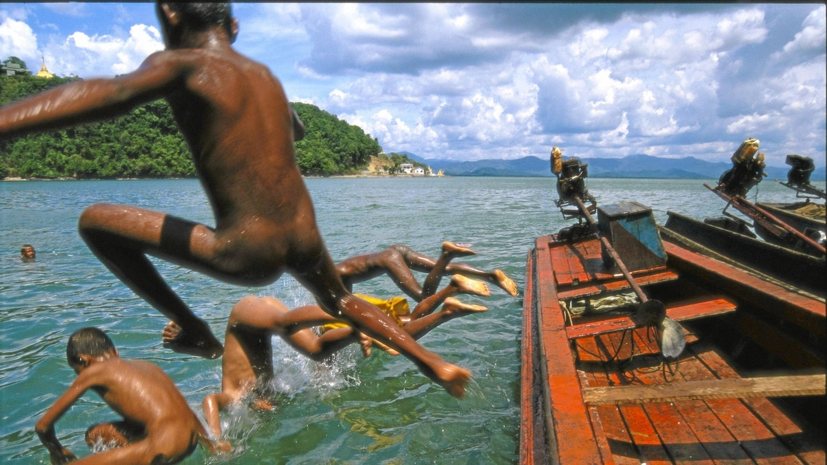 Children working on a ferryboat cool off in Kawthaung, Burma.