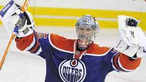 Edmonton Oilers goalie Nikolai Khabibulin (35), from Russia, celebrates his team's win in the overtime shootout of an NHL hockey game in Edmonton, Alberta on Tuesday, October 6, 2009. The good news for the Edmonton Oilers is Khabibulin already appears to be in mid-season form. The bad news, with all the rubber the steadfast Russian goaltender has faced, is he's had to be. THE CANADIAN PRESS/Jimmy Jeong
