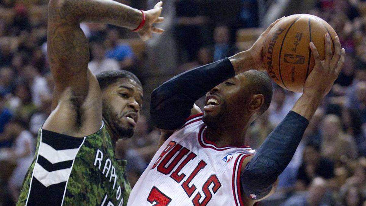 Chicago Bulls' C.J. Watson drives to the net past Toronto Raptors' Amir Johnosn during first half NBA play in Toronto on Wednesday.