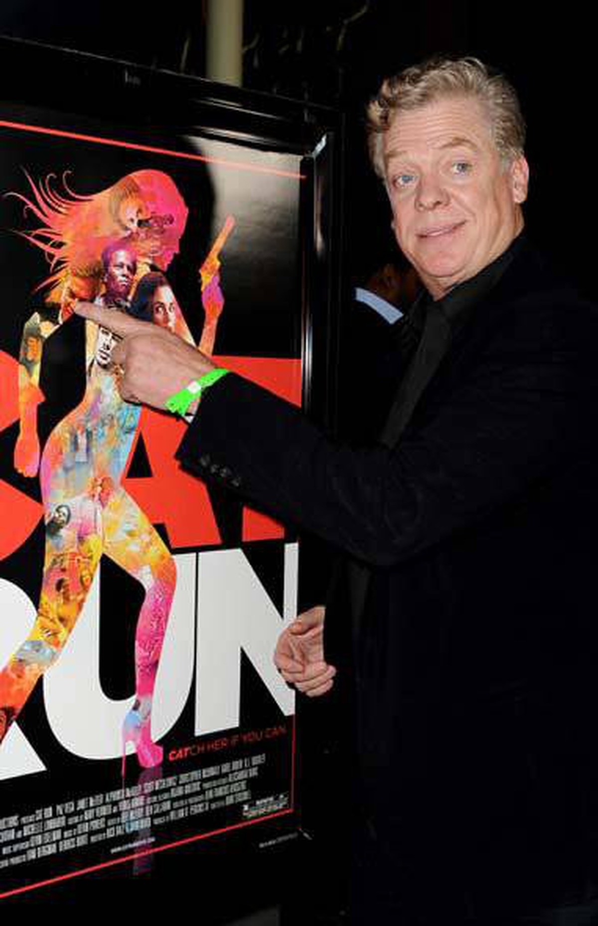 """Actor Christopher McDonald arrives at the premiere of """"Cat Run"""" in Los Angeles last week, a movie in which he plays the part of a tattoo on some woman's upper left arm."""
