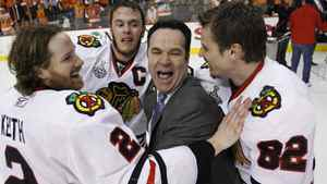 Chicago Blackhawks defenseman Duncan Keith (2), center Jonathan Toews, second from left, and right wing Tomas Kopecky (82), of Slovakia, celebrate with assistant coach John Torchetti after the Blackhawks beat the Philadelphia Flyers 4-3 in overtime to win Game 6 of the NHL Stanley Cup hockey finals on Wednesday, June 9, 2010, in Philadelphia. (AP Photo/Matt Slocum)