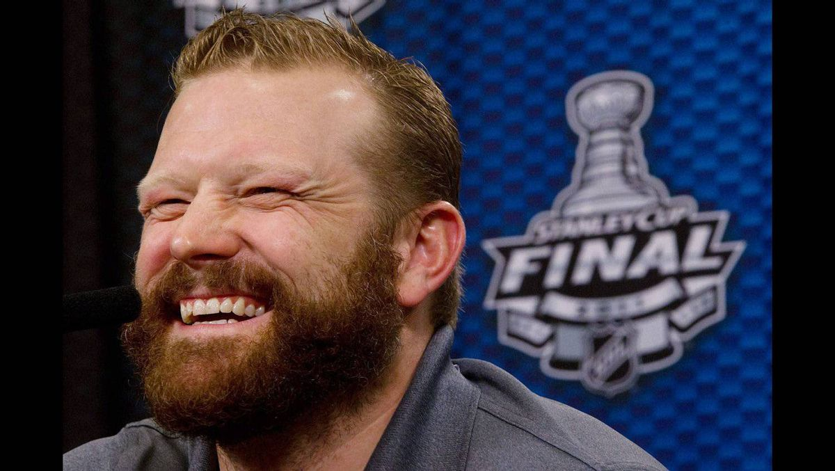 Boston Bruins' goalie Tim Thomas laughs as he speaks to reporters in Vancouver, B.C., on Tuesday June 14, 2011.