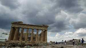 Tourists walk around the temple of the Parthenon at the archaeological site of the Acropolis hill in Athens June 16, 2011.