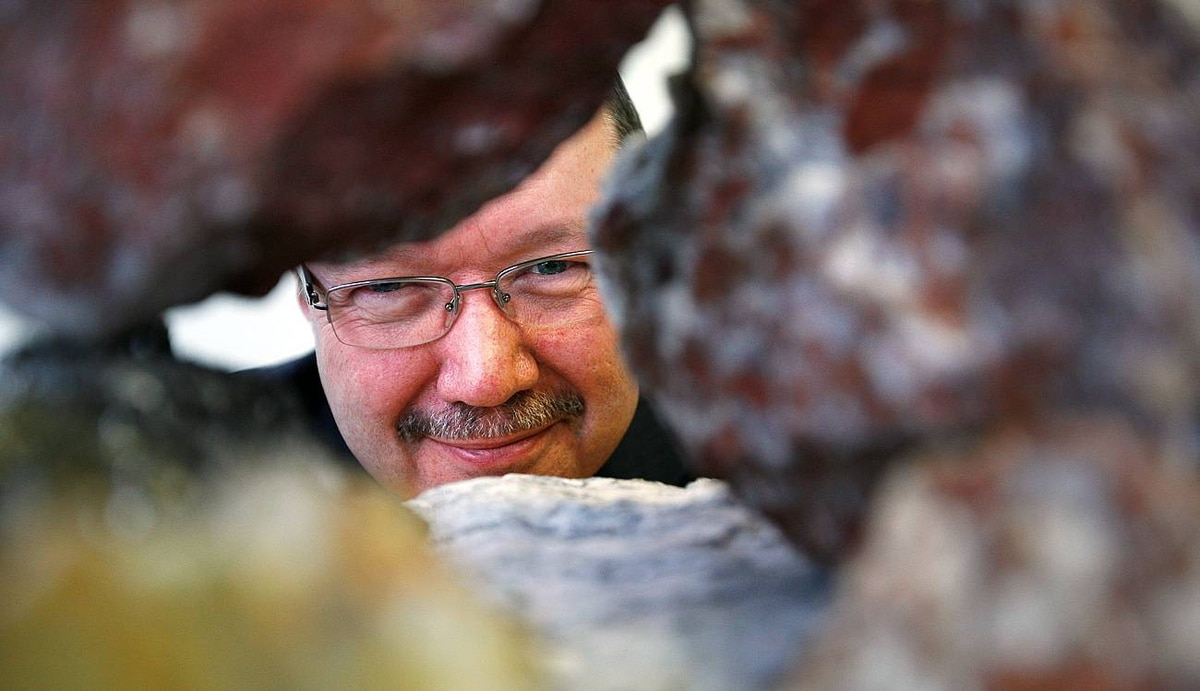 Don Bubar, P.Geo., President and Chief Executive Officer of Avalon Rare Metals Inc., poses for a photo looking through a collection of rare metal samples in the company offices in Toronto, Ontario, Canada.
