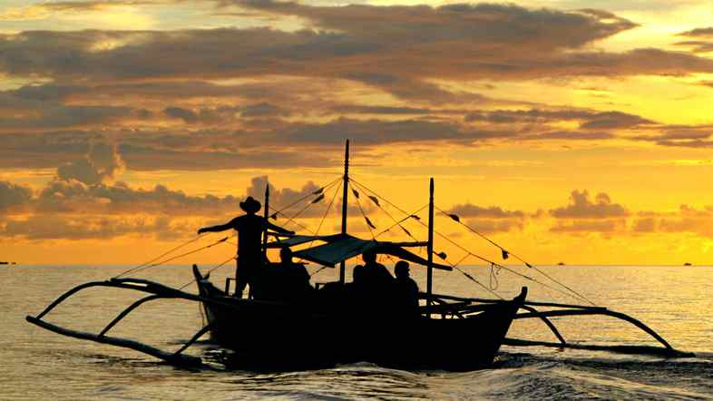 An outrigger is needed to reach the world's longest underground navigable river, but it does come with epic sunsets.