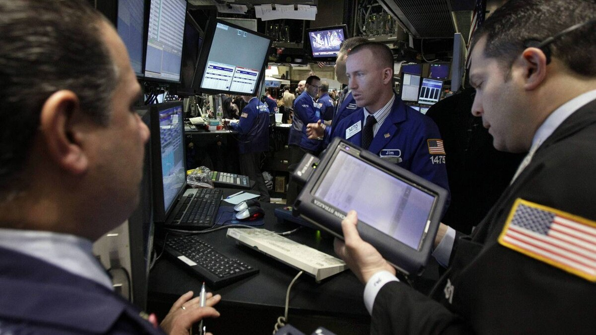 Traders work on the floor of the New York Stock Exchange Wednesday, March 16