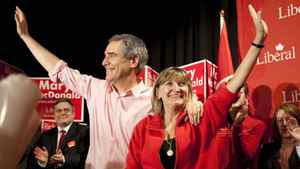 Liberal leader Michael Ignatieff and his wife Zsuzsanna Zsohar wave to the crowd as they attend a campaign rally in Edmonton on Saturday, April 16, 2011.
