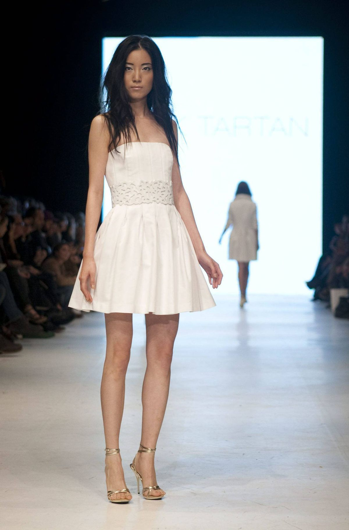 There's usually an angelic white frock or two in an uber-feminine collection like Pink Tartan. This strapless full-skirted number was delicate in texture and movement and sweet as a cupcake.