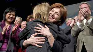 Premier-designate Christy Clark hugs her nine -year-old son, Hamish, at a the B.C. Liberal convention in Vancouver on Feb. 26, 2011.