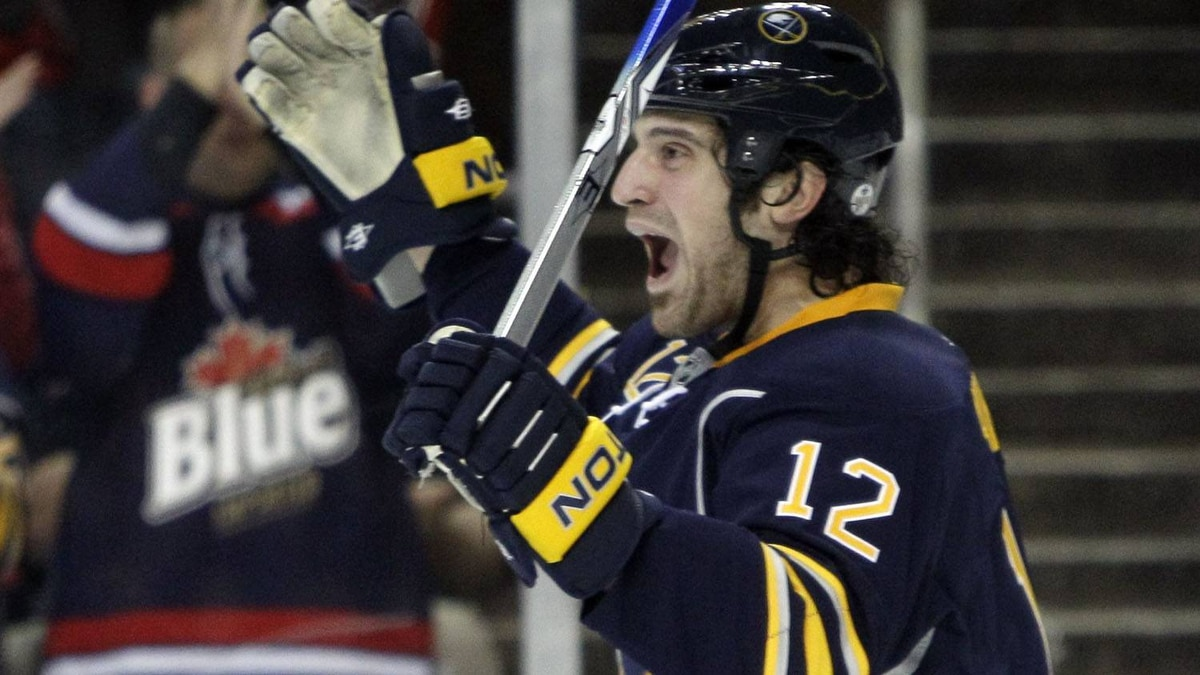 Buffalo Sabres' Mark Mancari celebrates his goal against the Atlanta Thrashers during the first period of an NHL hockey game in Buffalo, N.Y., Saturday, March 19, 2011. The Sabres won 8-2. (AP Photo/David Duprey)