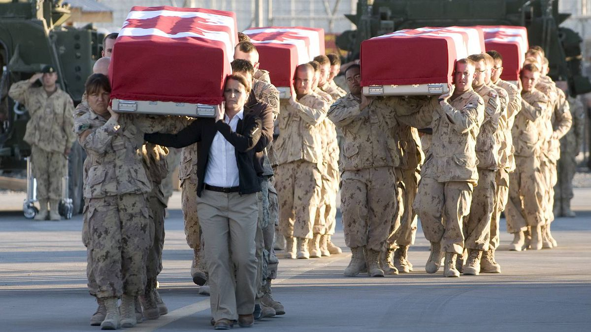 """Sgt Gemma Bibby photo, sent to us by A. Belyea, who writes """"On Nov 11th, please remember the 152 lost souls and the hundreds of others who will carry scars from the Afghan war with them for the rest of their lives."""" This image is of the repatriation of Private Garrett Chidley, Michelle Lang, Corporal Zachery McCormak, Sergeant George Miok and Sergeant Kirk Taylor, who were killed when their vehicle hit an IED on Dec. 30, 2009. The ramp ceremony took place on Jan. 01, 2010 at Kandahar Airfield, Afghanistan."""