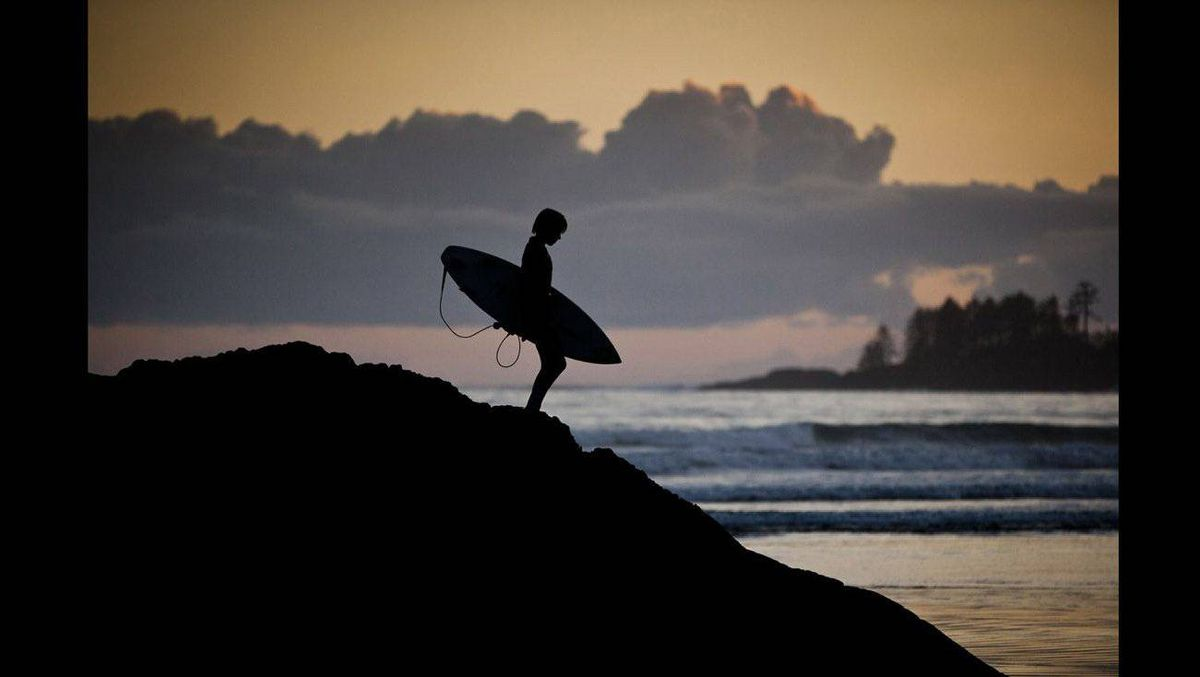 1st Place Sports Feature -- A young surfer checks out the last few ridable waves of the day at Long Beach South of Tofino October 14, 2010.
