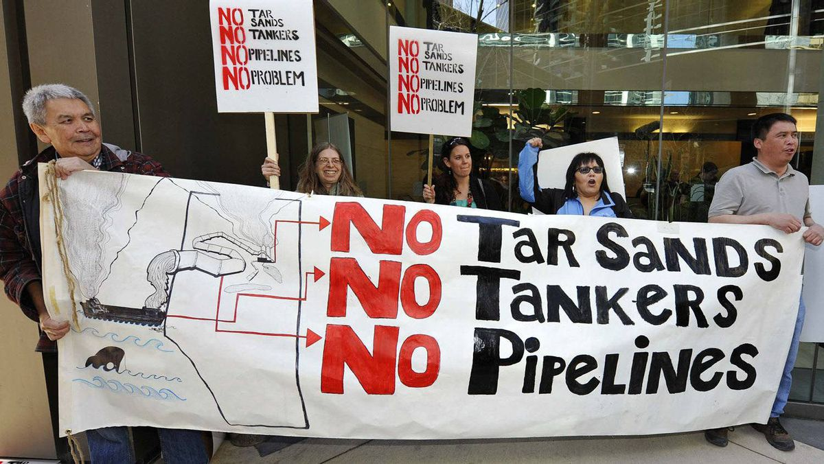 Aboriginals from British Columbia protest in front of the headquarters of Enbridge before the company's annual general meeting in Calgary, Alberta, May 11, 2011.