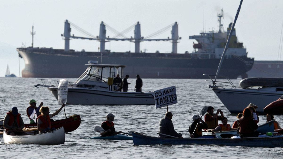 A flotilla of boats and kayakers gather on Burrard Inlet in Vancouver to protest against the use of crude oil tankers on the B.C. coast on Oct. 17, 2010.