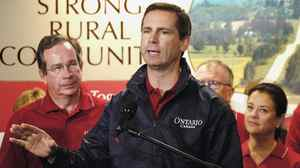 Premier Dalton McGuinty talks to reporters as MPP Jeff Leal (left) looks on in this Sept. 19, 2006 file photo. Mr. Leal is rumoured to be on his way in.