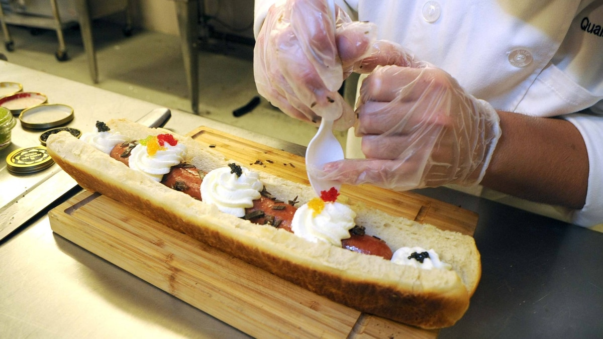 Ben Glanz, quality control executive chef, prepares the foot-long hot dog with toppings on July 20, 2011. The Brockton Rox of the Can-Am League announced on Wednesday that the club will attempt to set the Guinness Book of World Records' mark for the most expensive hot dog.