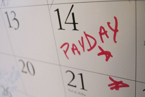 Calender close up with a pay day marked with red pen.