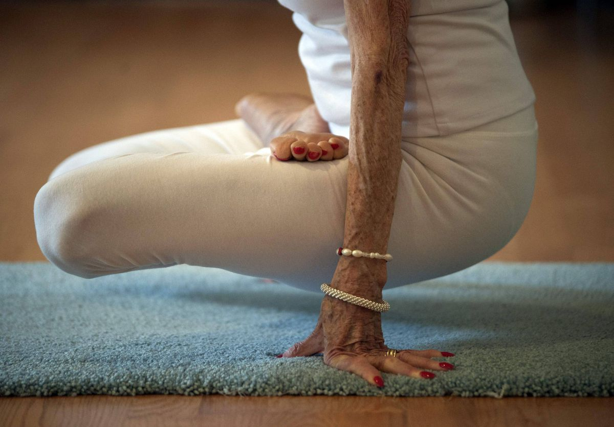 Yoga instructor Tao Porchon-Lynch goes through yoga poses in her yoga class in Hartsdale, New York, May 14, 2012. At 93 years old, Porchon-Lynch was named the world's oldest yoga teacher by Guinness World Records.