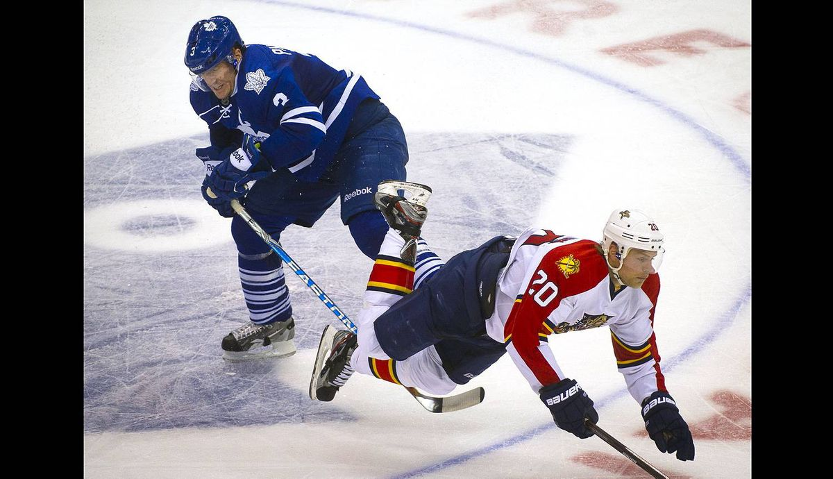 The Florida Panthers' Sean Bergenheim is sent flying as he is tripped by the Toronto Maple Leafs' Dion Phaneuf at the Air Canada Centre.