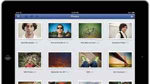 This product image provided by Facebook shows the Facebook application as shown on an iPad screen. Facebook is releasing an updated version of its iPhone application on Monday afternoon, Oct. 10, 2011, one that's also designed to fill out the larger screen of the iPad. Like the previous iPhone version, it's free.
