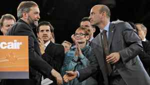 Thomas Mulcair shakes hands with third-place candidate Nathan Cullen after the Quebec MP won on the fourth ballot at the NDP leadership convention in Toronto on March 24, 2012.