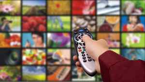iStockPhoto -- ROYALTY-FREE Digital television. Remote control. Changing Channels, Close-up, Collection, Color Image, Concepts, Digitally Generated Image, Film, Film Industry, Film Reel, Flat Screen, High Definition Television, Holding, Horizontal, Human Body Part, Human Hand, Liquid-Crystal Display, Modern, Photography, Remote Control, Selective Focus, Technology, Television Set, The Media, Video, Video Still, Visual Screen, Watching TV, Wide, Wide Screen