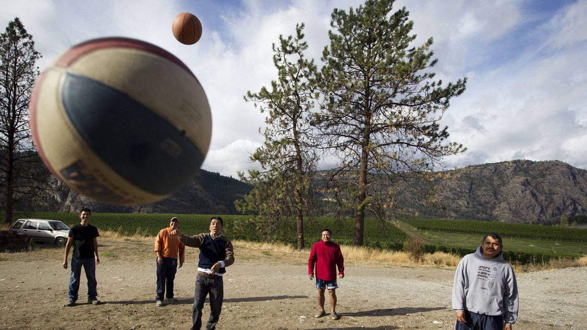 Mexican migrant workers play basketball at the Blue Mountain Vineyard and Cellars in Oliver Oct. 4, 2011.