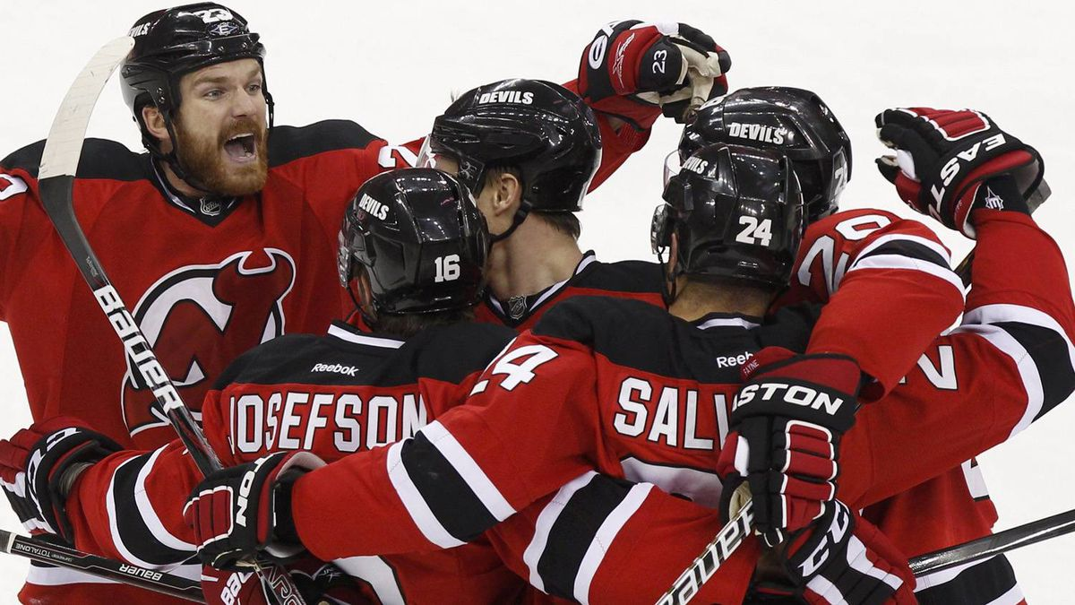 New Jersey Devils' David Clarkson (L) celebrates with goal scorer Bryce Salvador (24) and other teammates against the New York Rangers during the first period in Game 4 of their NHL Eastern Conference Final hockey playoff game in Newark, New Jersey May 21, 2012. REUTERS/Adam Hunger