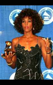 Ms. Houston poses with her Grammy Award in March, 1988.
