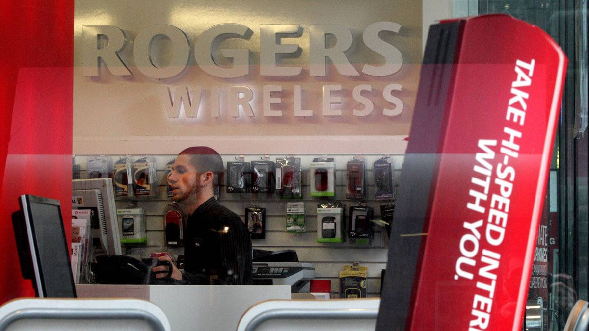 An employee works inside a Rogers Wireless retail store in Vancouver, B.C