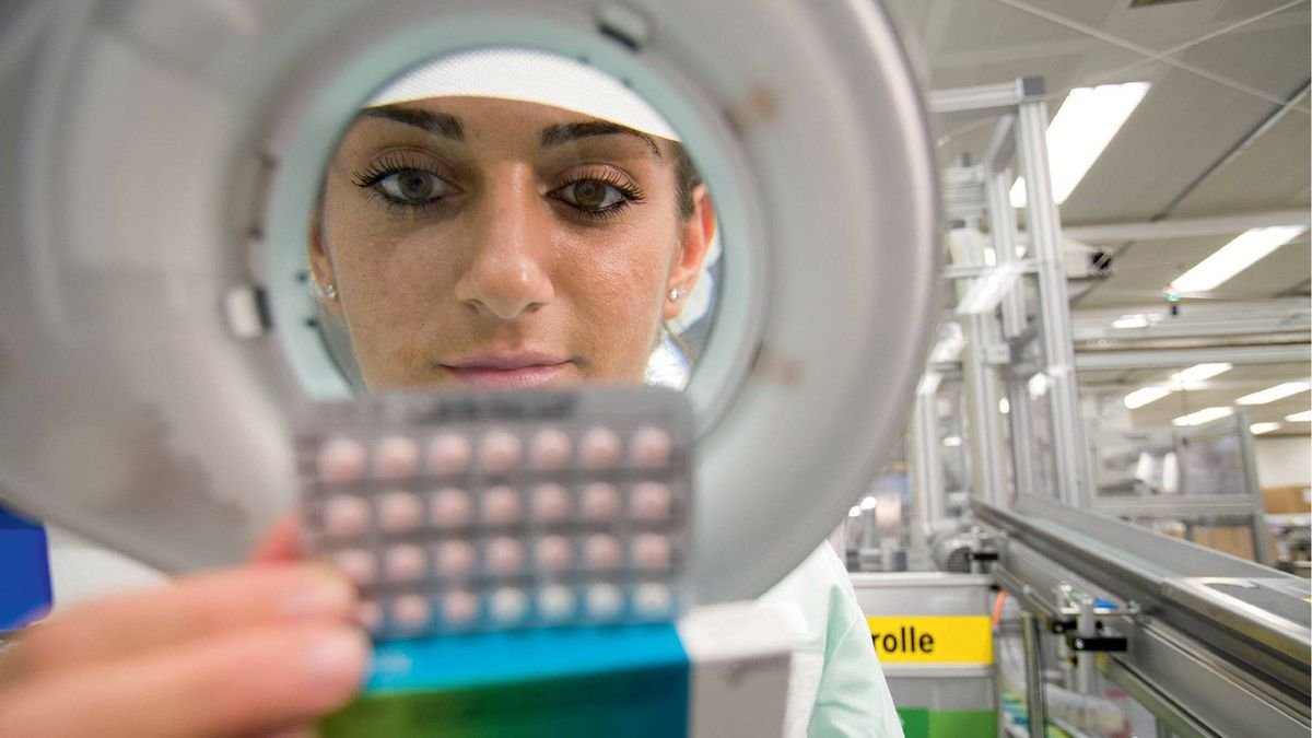 A Bayer Schering Pharma employee examines YAZ birth control pills in the company's factory in Berlin, Germany, in this undated handout photo, released to the media on Friday, Jan. 15, 2010.