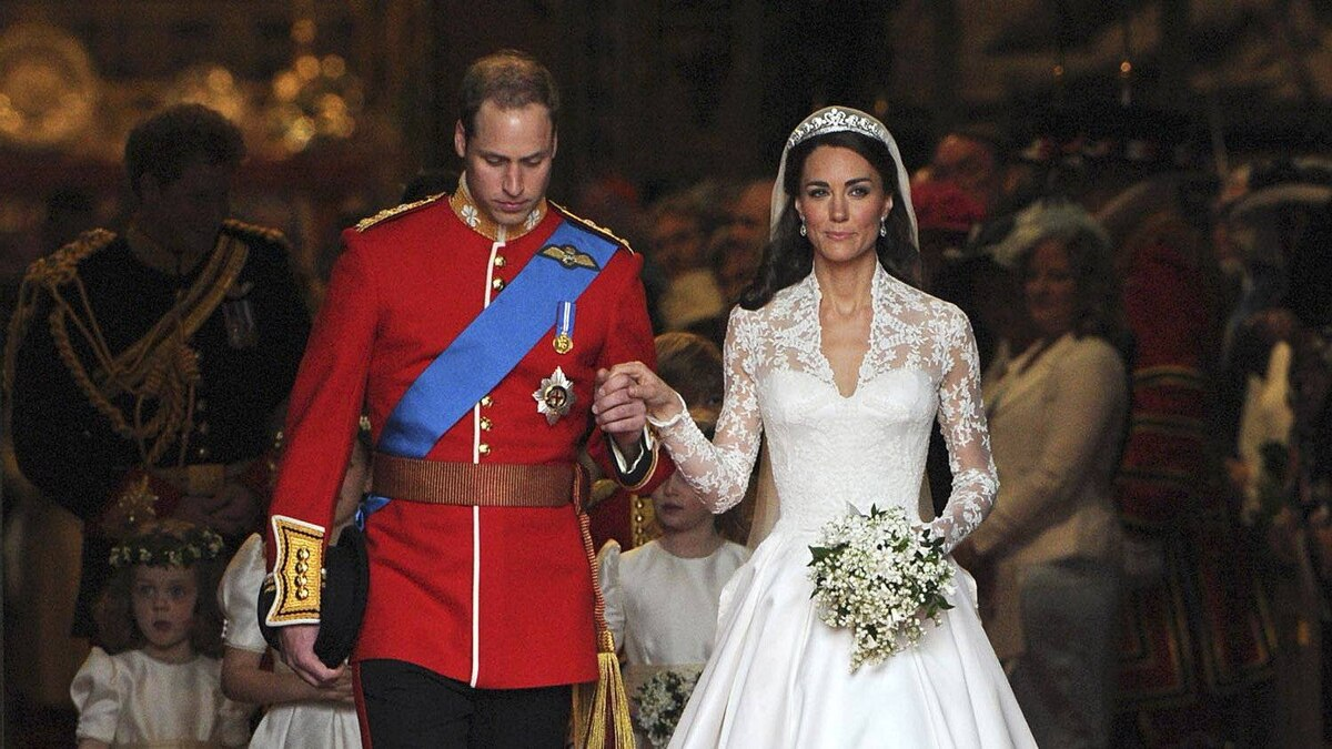 Britain's Prince William and his wife Kate, Duchess of Cambridge, leave Westminster Abbey after their wedding ceremony, in London, on April 29, 2011.